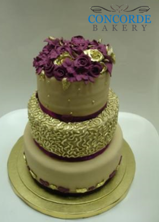 gold and purple wedding cake